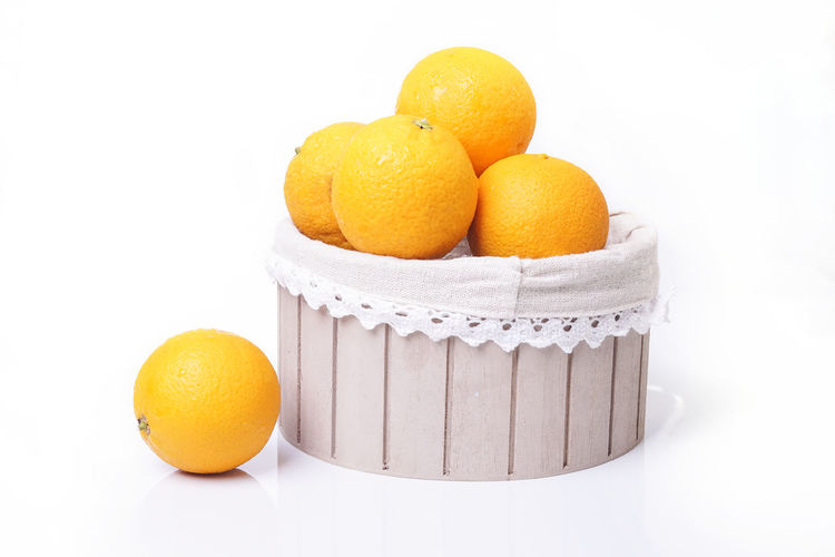 Basket of fresh orange fruit isolated on white background Detox Orange Citrus Fruit Close-up Day Food Food And Drink Freshness Fruit Healthy Eating Healthy Lifestyle No People Orange - Fruit Orange Color Studio Shot Vitamin White Background Yellow