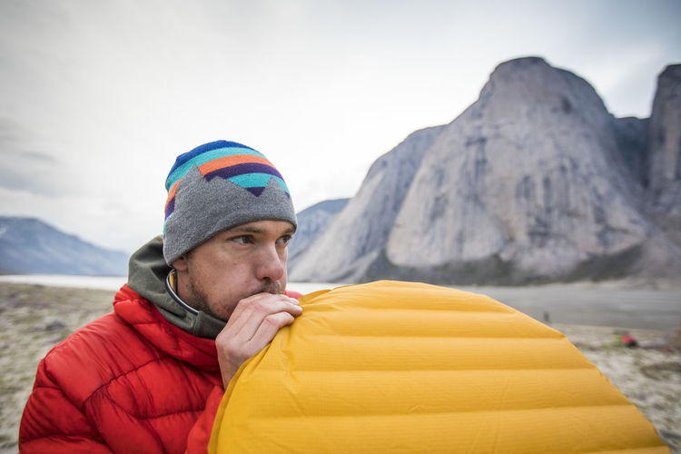 Portrait of man in mountains during winter