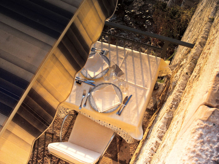 High angle view of sunshade and restaurant table