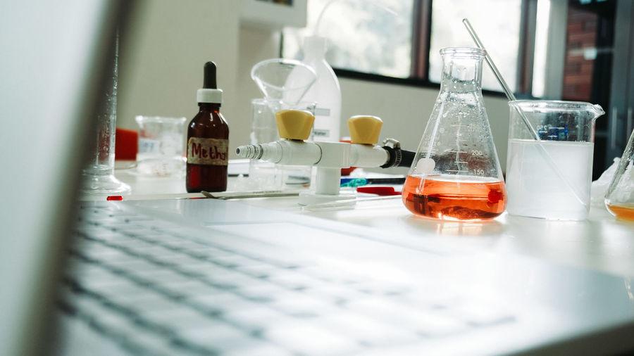 Glass bottles on table
