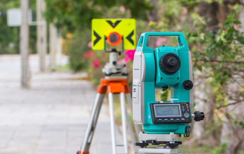 Surveyor equipment tacheometer or theodolite outdoors at construction site Camera Camera - Photographic Equipment City Close-up Communication Creativity Day Digital Camera Equipment Focus On Foreground Footpath Green Color Multi Colored No People Outdoors Photography Themes Road Robot Street Technology