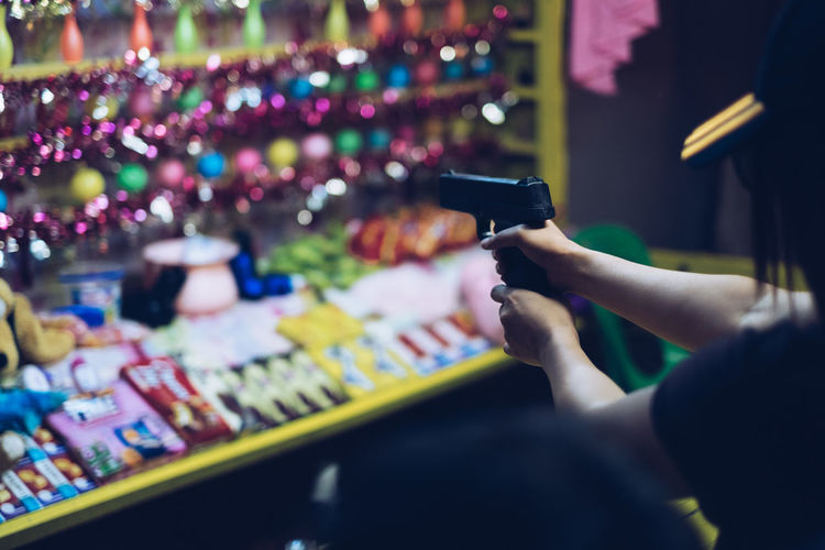 Close-up of hand holding gun toy