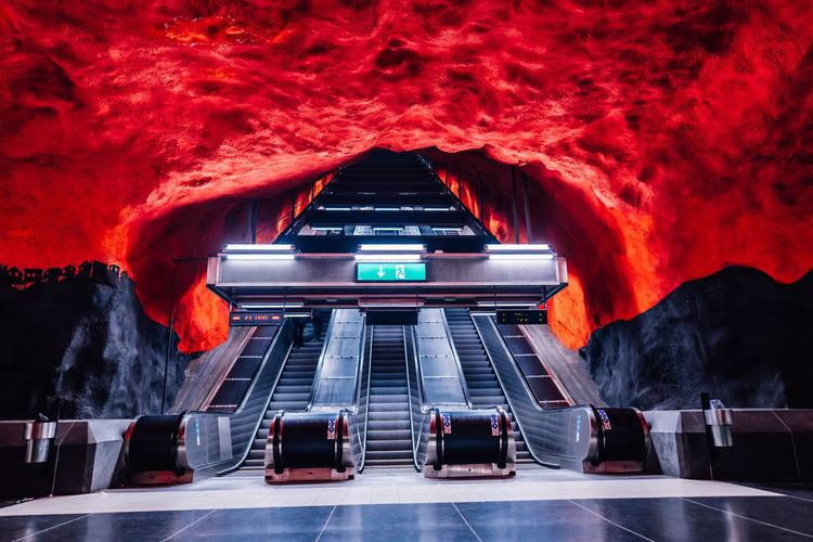 Low angle view of illuminated escalators