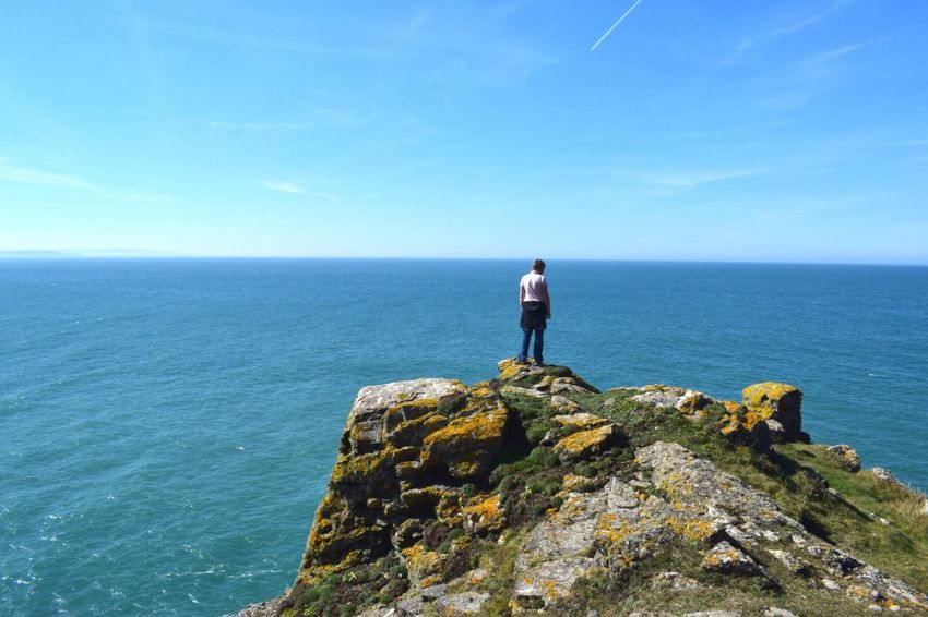 Staring out to Sea Horizon Over Water Water Sea Scenics Standing Nature Beauty In Nature Rear View Sky One Person Blue Rock - Object Real People Idyllic Leisure Activity Outdoors Walking And Exploring Headland Cornwall Exercising In Nature Lost In The Landscape EyeEm Ready