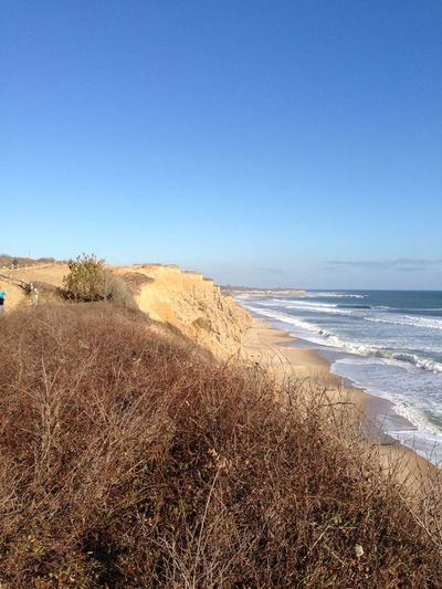 Ditch Plains cliffs Montauk NY Arid Climate Beach Cliff Cliffs Coastline Ditch Plains Geology Horizon Over Water Montauk Non-urban Scene Outdoors Physical Geography Remote Rock Rock - Object Rock Formation Sand Scenics Sea Tranquil Scene Tranquility Trip