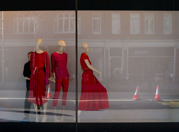 Red mannequins Architecture City London Mannequins Reflection Road Stories From The City Buildings Close-up Day Red Red Clothes Shop Shop Window Shop Window Dummies Street Street Photography Traffic Cones Window Window Dresser