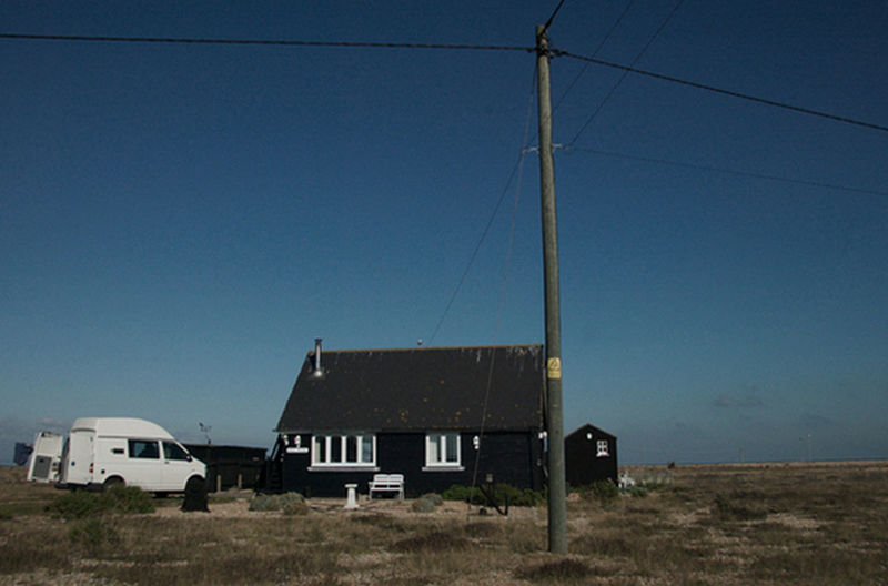 Black House against Big Blue Sky, Dungeness Architecture Black Hut With White Van Landscape Barren Beauti Big Sky Building Building Exterior Built Structure Clear Sky Copy Space Direction Dungeness Photostory Beach Land Landscape Big Sky Skies Clouds Cloud Grasses Flat Barren Beauty Photography Photographer Photograph Images Colour Color Black And White Monochrome Documentary Reportage Taking Photographs Photos Fotos Film Digital Images An Environmental Conservation Flag Guidance Hanging House Landscape Dungeness Big Sky Skies Houses White Beach Sea Buildings Grass Sand Plants Photography Photographer Photograph Documentary Reportage Taking Photos Fotos Foto Photo Taking Photos Film Digital Image Color Colour Low Angle View Pole Sign Street Light Technology Vignette Wall Window Wood