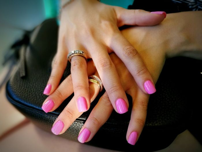 Cropped Hands Of Woman With Pink Nail Polish