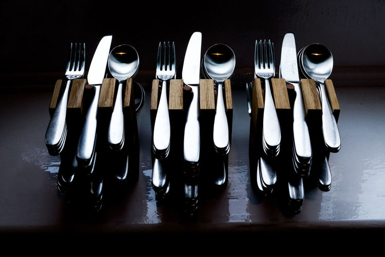 Fine Dining Restaurant Knife Silverware  Spoon Arrangement Close-up Cutlery Cutlery And Crockery Cutlery Holder Cutlery Set Day Dining Table Eating Out Fine Dining Fork Hanging In A Row Indoors  Knife And Fork Knifes Knives Large Group Of Objects No People Table Ware Wooden Texture