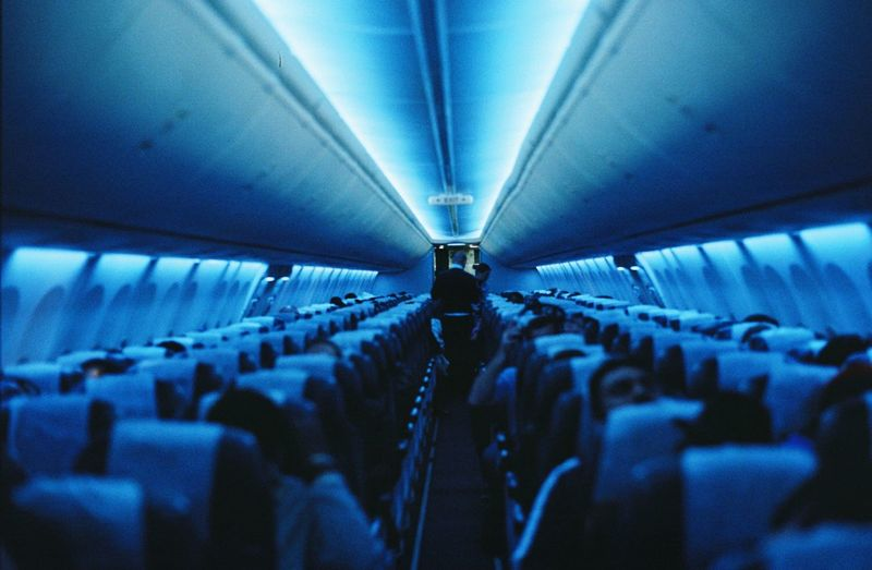 Group of people in illuminated airplane