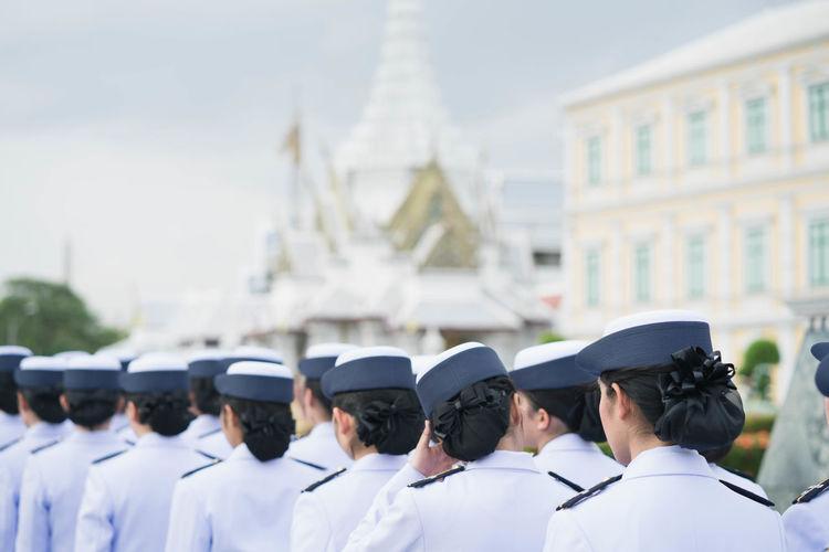 Rear view of women wearing uniform