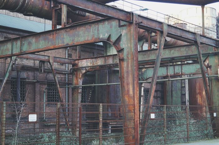 Vintage colors Built Structure Architecture Abandoned No People Outdoors Adapted To The City Trees Grass Urban Geometry Building Exterior Shades Of Green  Workers Lines Metal Ironworks Technology Steelwork Factory Vintage Objects Full Frame Industry Rusty Facades Old Buildings The Architect - 2017 EyeEm Awards
