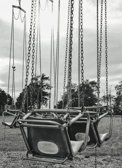 View of swing in park against clear sky