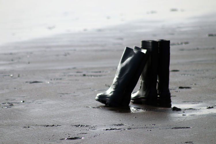 Boots on sand at beach