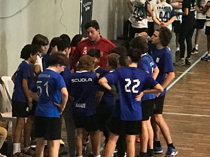 Team work Scuola Italiana Di Montevideo. (sim) Handball Match Forza Azzurri! Sport Group Of People People Crowd Athlete Punishment Clothing Sports Uniform Stadium Real People Outdoors Competition Architecture Communication Number Standing Blue Match - Sport