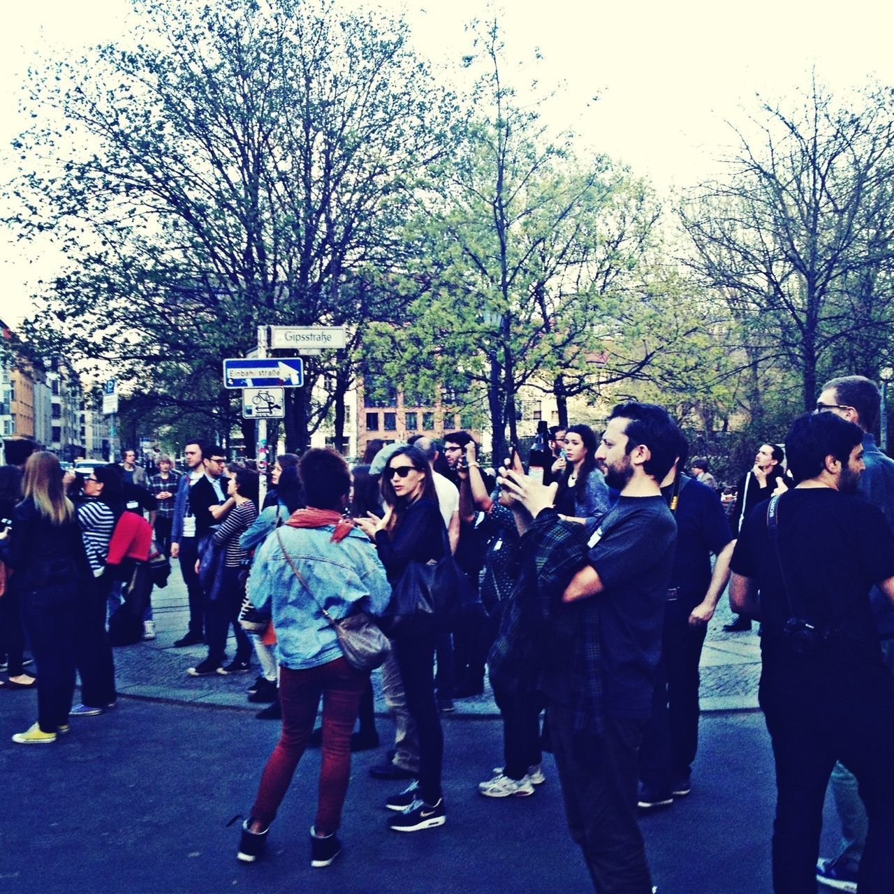 PEOPLE LOOKING AT CITY STREET