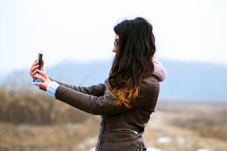 Young Woman Taking Selfie Outdoors