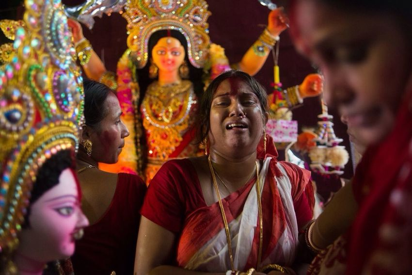 A hindu devotee breaks into tears in front of the goddess idol after fasting for at least 3 consecutive days in old dhaka, bangladesh. The Storyteller - 2014 Eyeem Awards Hindu Woman