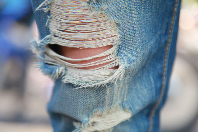 Close-Up Of Person Wearing Torn Jeans Pant