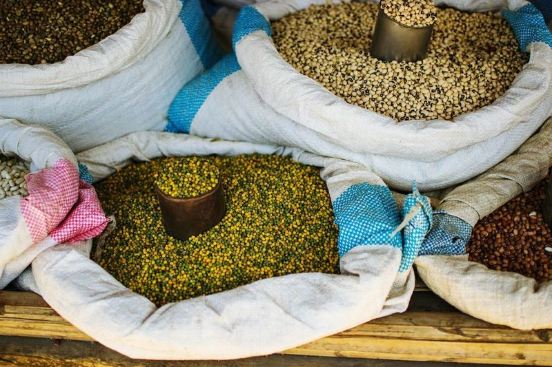 High Angle View Of Various Beans In Sacks For Sale At Market