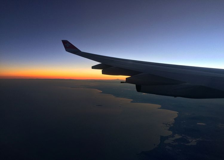 At Dusk over Kaspian Sea From An Airplane Window of Swiss Airlines
