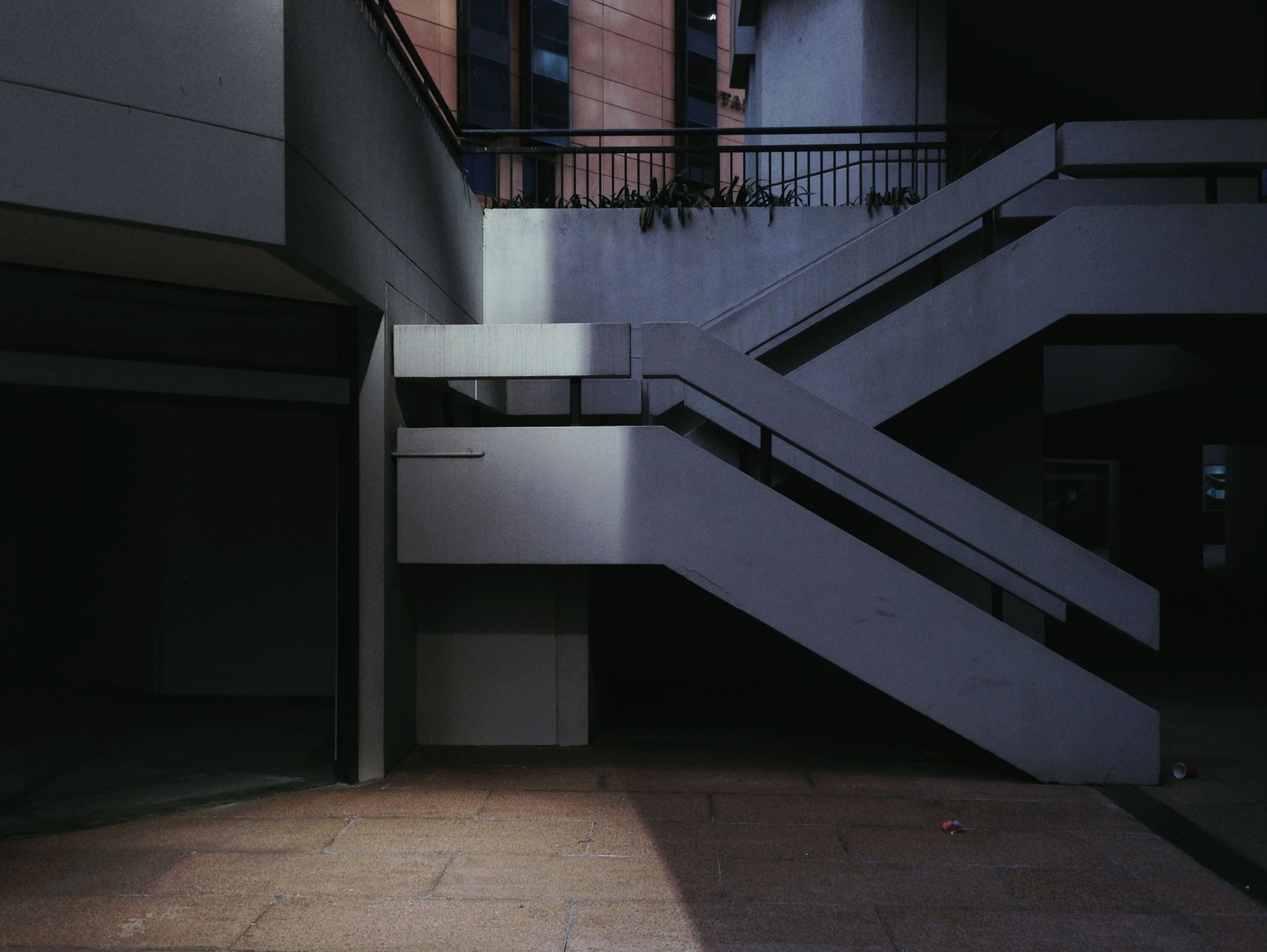 architecture, built structure, building exterior, building, city, window, residential building, sunlight, residential structure, shadow, empty, the way forward, railing, modern, no people, day, indoors, narrow, steps, tiled floor