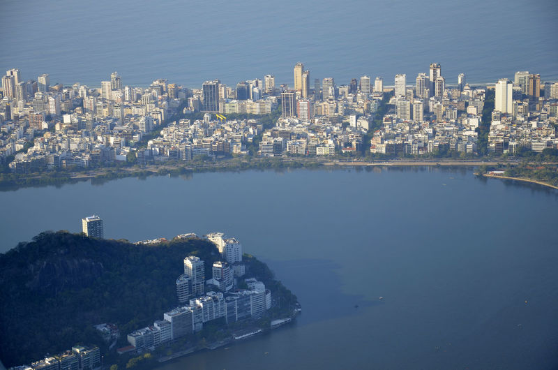 Aerial view of city amidst sea