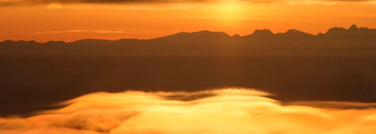 Sky Sunset Cloud - Sky Beauty In Nature Mountain Orange Color Scenics - Nature Tranquility Tranquil Scene Dramatic Sky Idyllic Nature No People Mountain Range Environment Sun Sunlight Silhouette Non-urban Scene Majestic