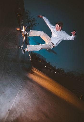 Full Length Of Man Skateboarding At Park