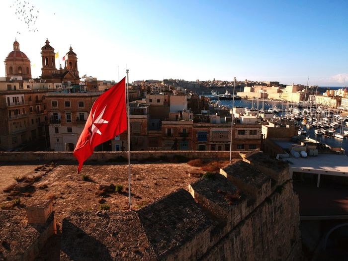 Malta summer holidays harbour boat drone old history fort beautiful Drone Shot Turism Old History See Harbour Drone  Malta Holiday Water Summer Cityscape City Politics And Government Patriotism Flag Sky Architecture Building Exterior Built Structure National Icon National Flag Flag Pole