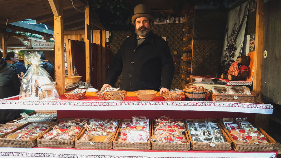 Portrait of man standing at market stall