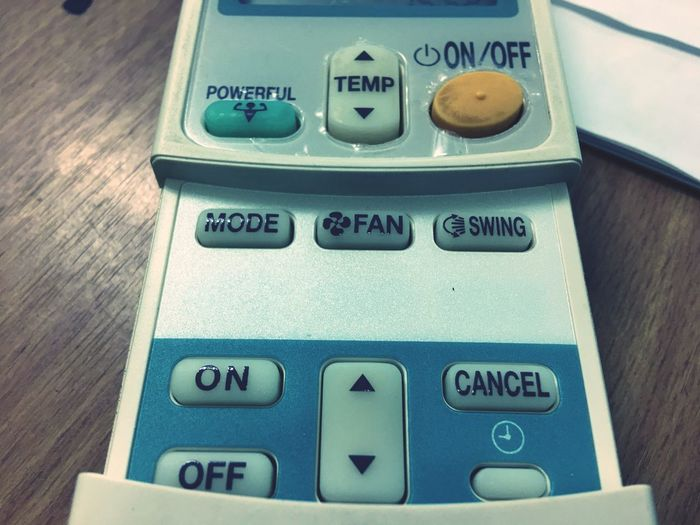 Airconditioning On Numeric Keypad Airremote Communication Close-up Indoors  No People Text Table Day Remote Control Remote Botton