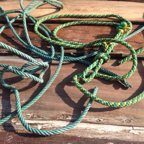High angle view of ropes on boardwalk