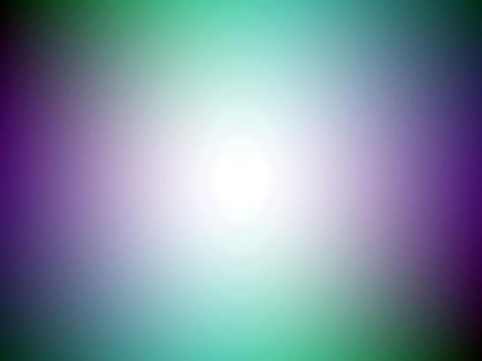 Defocused image of illuminated lights against sky