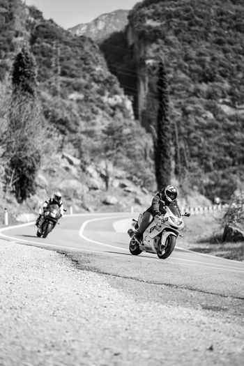 People riding motorcycle on road