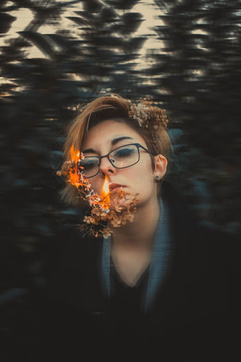 One Person Young Adult Young Women Lifestyles Portrait Leisure Activity Nature Glasses Hairstyle Headshot Burning Motion Real People Front View Outdoors Flame Fire Beautiful Woman