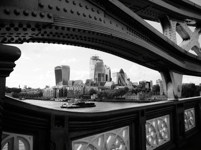 View of bridge and buildings against sky
