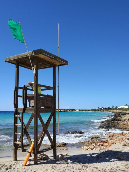 Beach Sea Water Safety Lifeguard  Sand Blue Protection Wood - Material Lifeguard Hut Nature Sky Horizon Over Water Built Structure Day Outdoors Tranquility Clear Sky No People Menorca Travel Destinations Excursions Beauty In Nature Nature Rock - Object