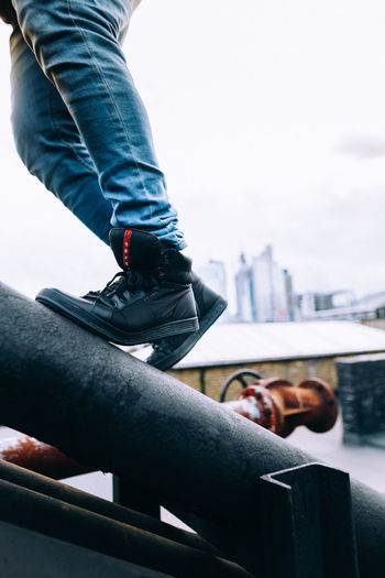 Architecture City City Life Cityscape Colors Exploring Fashion London Architecture Building Exterior Built Structure Day Explore Focus On Foreground Footwear Lifestyles Men Outdoors Prada Railing Real People Shoe Streetphotography Urban Urban Skyline