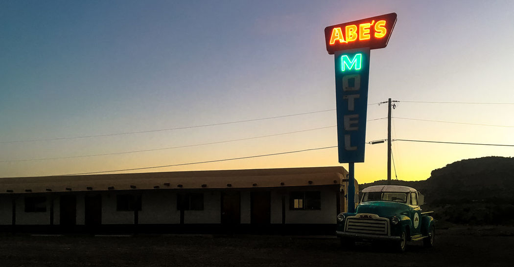 Abe's motel -- Driving in our RV off the beaten track in northern New Mexico, we stopped around sunset at Abe's Motel for the night. It was a desolate spot, reminding me of Hitchcock's classic 1960s film 'Psycho'. We're also close to Phoenix and at an empty motel, but Abe was much nicer than Norman Bates ... but, still ... 50s Look New Mexico, USA Sunset_collection US Road Trip Clear Sky Motel Motel Sign Neon Sign No People Old Car Outdoors Spooky Sunset Transportation The Week On EyeEm