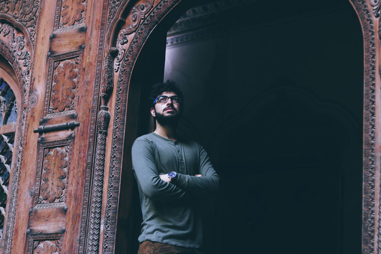 Casual Clothing Standing Glasses Architecture Indoors  Portrait Built Structure Contemplation One Person Young Adult Young Men Front View Wall - Building Feature Historical Building Historical Place Waist Up Leisure Activity