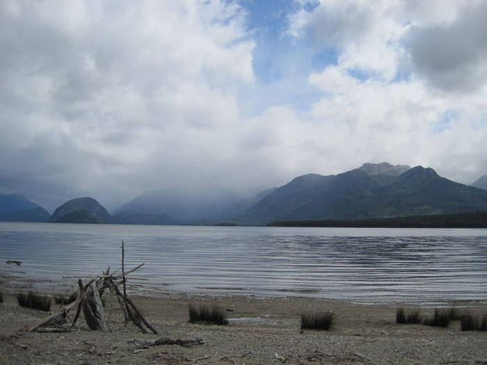 Water Cloud - Sky Sky Beauty In Nature Scenics - Nature Tranquil Scene Tranquility Mountain Lake Nature Day No People Beach Non-urban Scene Idyllic Land Mountain Range Outdoors New Zealand Kepler Track