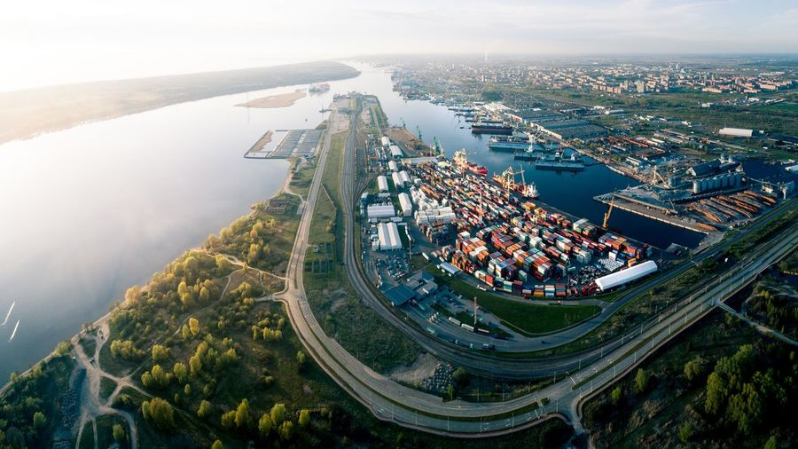 Aerial View of Port of Klaipeda, Lithuania Klaipeda Port Aerial Lithuania Lietuva Kursiu Marios Baltic Sea Ocean Harbor Ships Shipping  Container Ship Containers Aerial Photography Panoramic City Cityscape Urban Skyline Aerial View High Angle View Architecture Sky Landscape River Waterfront Boat Dock Commercial Dock Riverbank