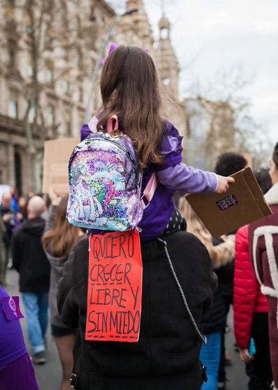 Rear view of women standing on street