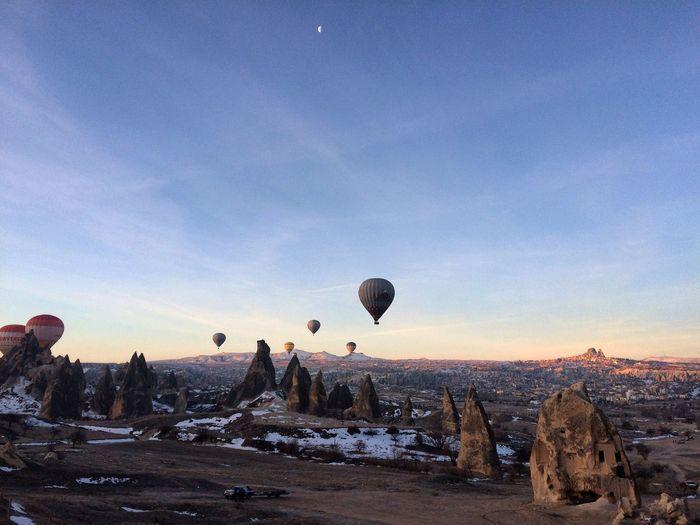 Hot Air Balloons Flying Against Sky At Cappadocia
