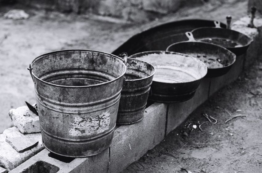 The Dishes // No water for washing, these pots and pans sit outside a makeshift home that does not have indoor plumbing. Nikon Border Stories Project Esperanza Beyond The Border Worldwaterday Mexico Photojournalism Poverty Blackandwhite Blackandwhite Photography The Photojournalist - 2016 EyeEm Awards The Street Photographer - 2016 EyeEm Awards The Portraitist - 2016 EyeEm Awards