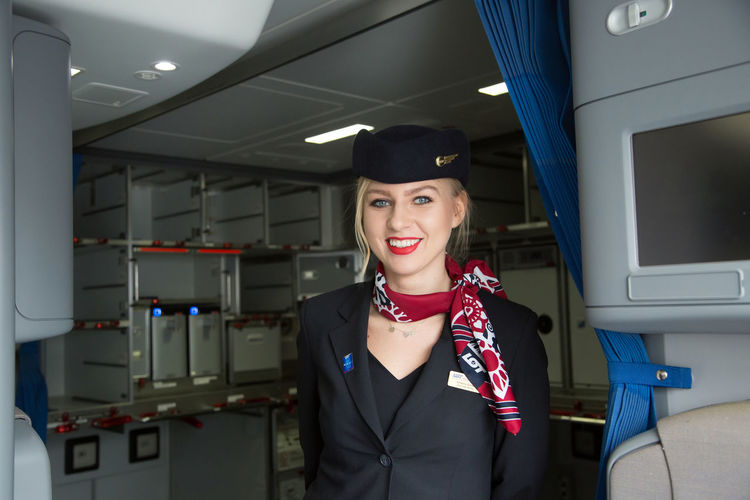 Polish Stewardessa Beautiful Woman Cheerful Day Front View Happiness Indoors  Looking At Camera Occupation One Person One Young Woman Only Portrait Real People Smiling Standing Stewardessa Toothy Smile Well-dressed Young Adult Young Women