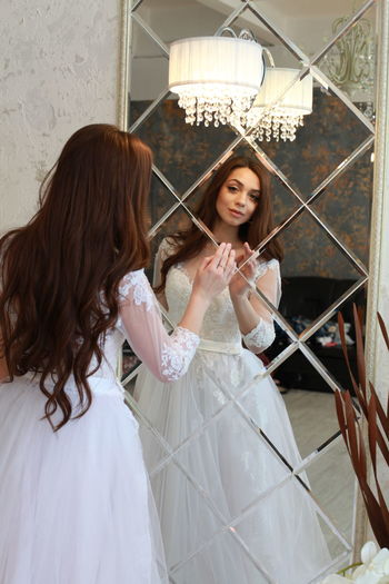 Wedding Wedding Dress Wedding Photography Newlywed Bride Mirror Mirror Reflection Looking Through Young Adult Women Young Women Real People Lifestyles Adult Indoors  Long Hair Event Reflection Happiness Celebration Smiling Portrait Beautiful Woman Hairstyle Hair