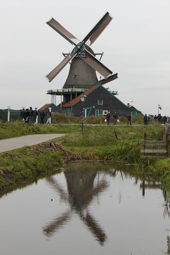 Agriculture Alternative Energy Architecture Building Exterior Built Structure Environmental Conservation Mill Nature No People Outdoors Reflection Renewable Energy Rural Scene Sky Surface Traditional Windmill Water Watermill Wind Power Wind Turbine Windmill
