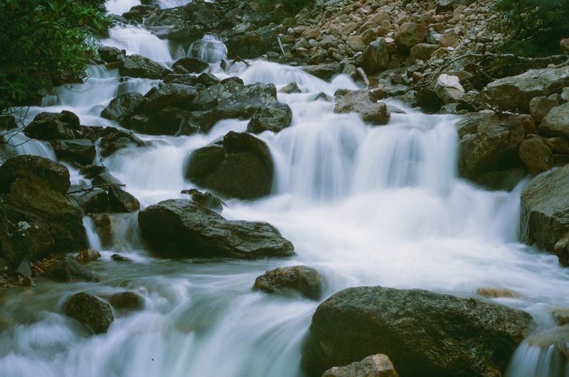 Beauty In Nature Blurred Motion Day Flowing Flowing Water Forest Land Long Exposure Moss Motion Nature No People Outdoors Power In Nature Rainforest River Rock Rock - Object Scenics - Nature Solid Stream - Flowing Water Water Waterfall